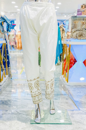 Cream trouser with gold colour embroidery at ankle
