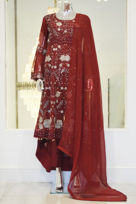 Long maroon dress designed with silver diamonds