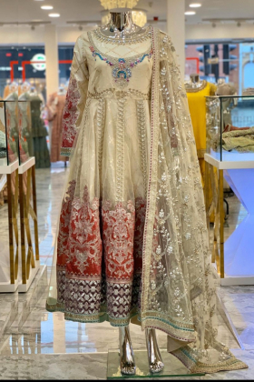 Three piece bead embroidered frock style suit in cream