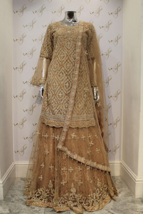Gold heavy embroided partywear with lengha