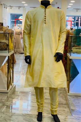 Gold raw silk material men's shirt with silver buttons and churidar trousers
