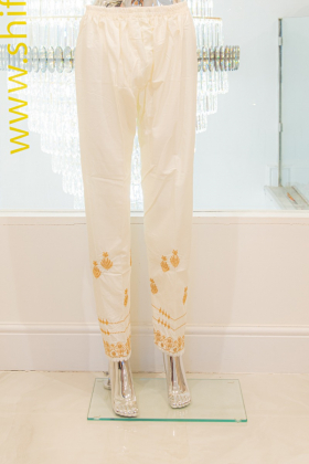 White linen trousers with gold detailing