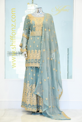 Green lengha suit with gold embroidery