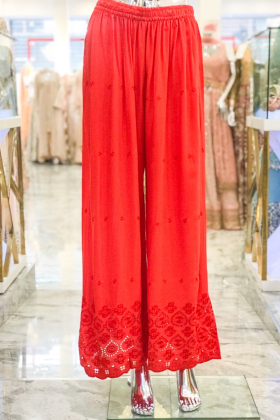 Red linen trousers with threadwork border