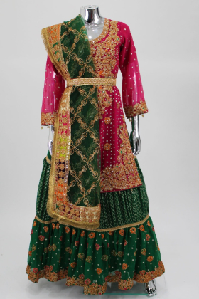 Pink luxury embroidered lengha suit by IVANA