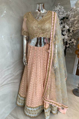 3 Piece luxury embroidered chiffon lengha choli in peach and sky blue