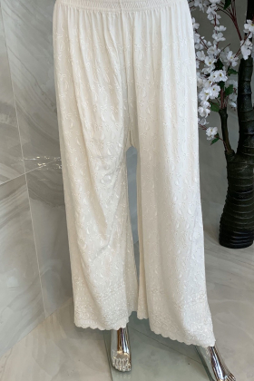 Light weight thread-work embroidered lawn trousers in white