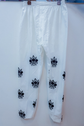 White lawn trousers with black detailing